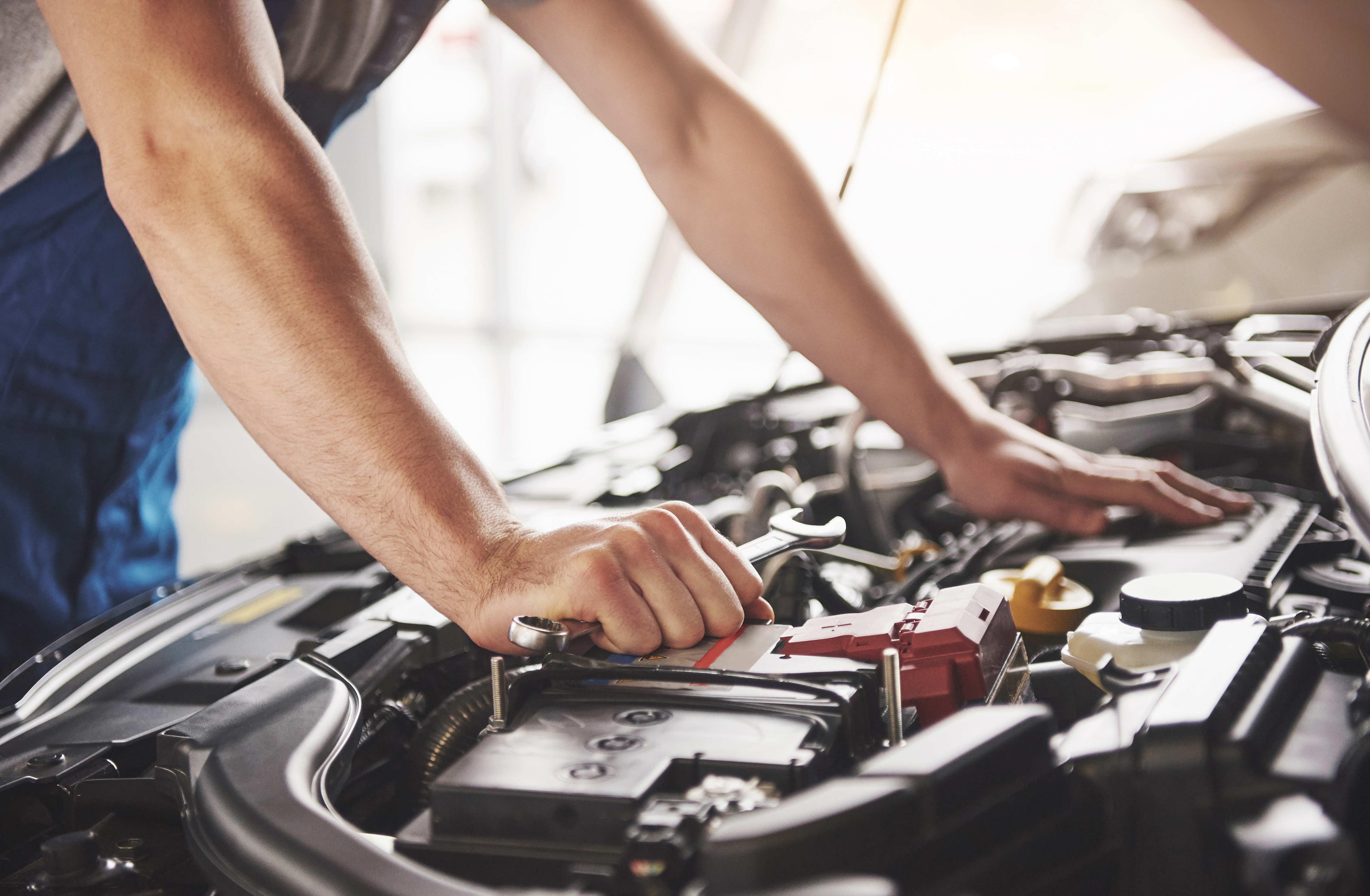 auto-mechanic-working-garage-repair-service-thumbnail