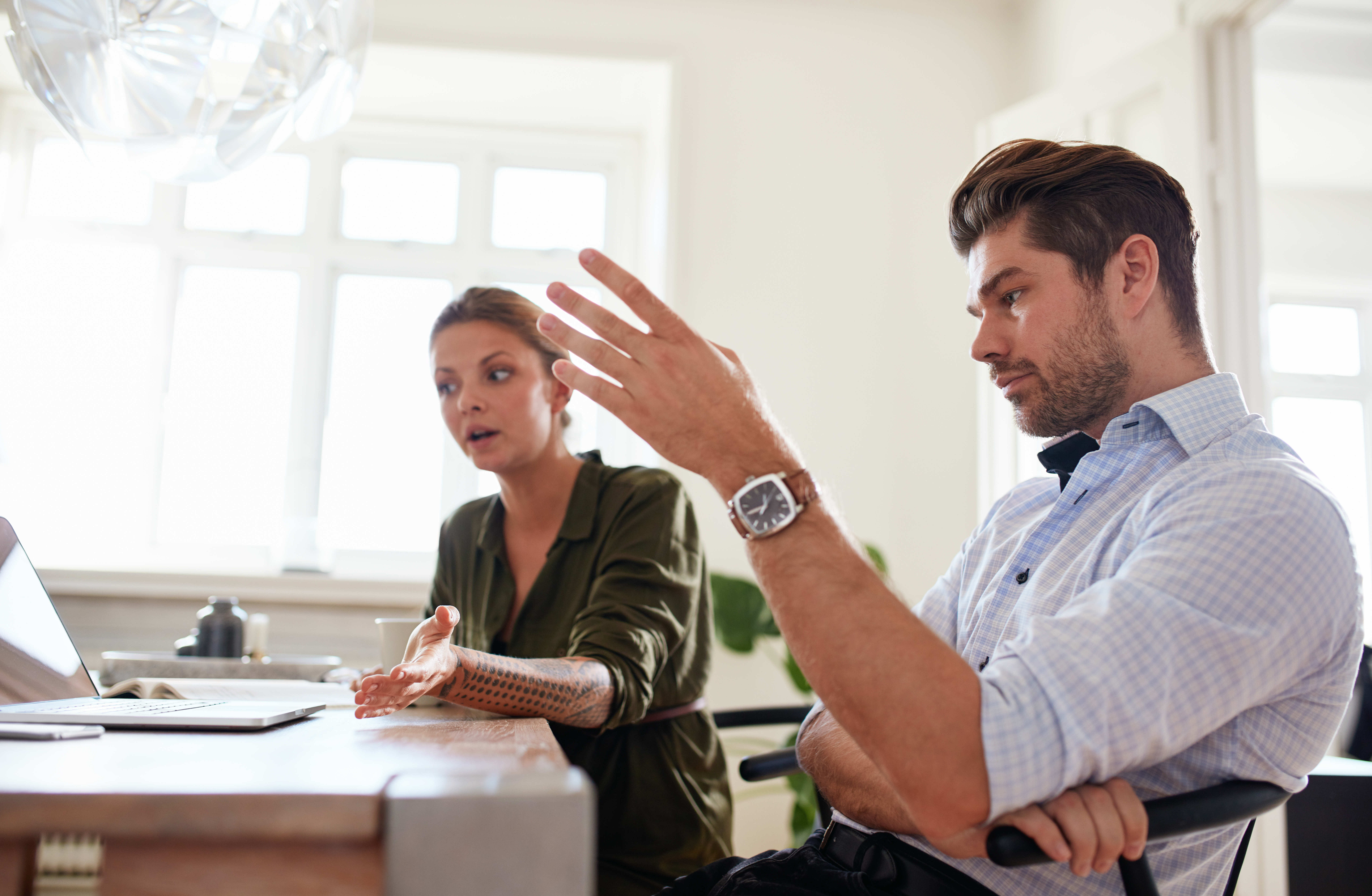 young-couple-at-home-office-discussing-insurance-claims-content-image