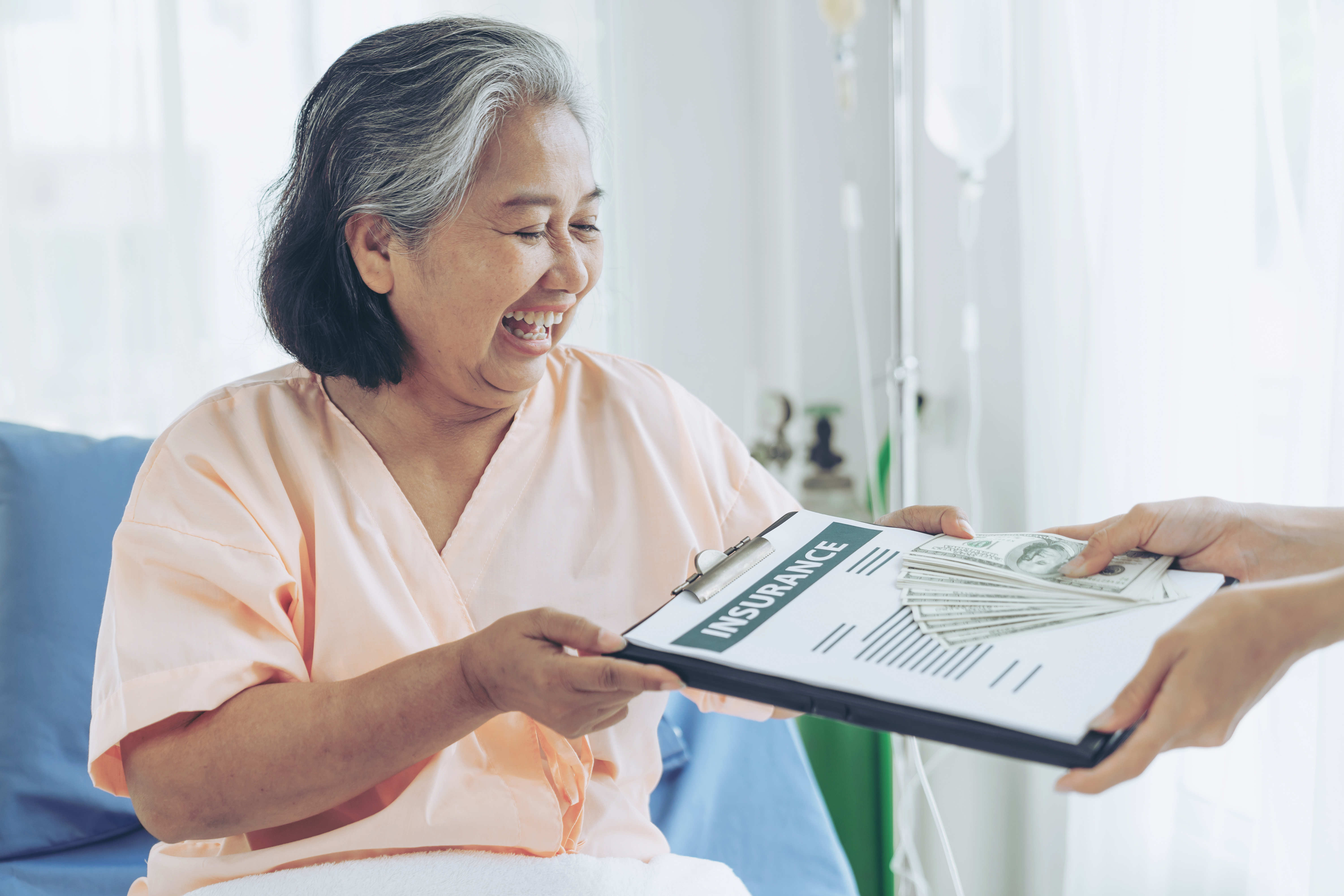 elderly-patients-injury-woman-patient-bed-hospital-holding-us-dollar-bills-feel-happy-from-getting-benefits-life-health-money-from-insurance-companies-content-image
